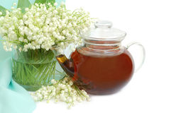 Lily of the valley and teapot Royalty Free Stock Image