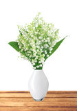 Lily of the valley in vase on table isolated on white Royalty Free Stock Photo