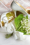 Lily of the valley and wedding shoes Royalty Free Stock Images