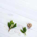 Lily of the valley in wooden background. Royalty Free Stock Images
