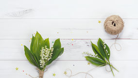 Lily of the valley in wooden background. Royalty Free Stock Photography