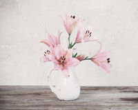 Lily in vase on background old  wall Royalty Free Stock Photo