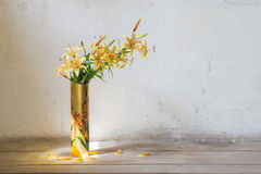 Lily in vase on background  white wall Stock Image