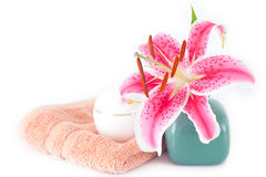 Lily in a vase, towel and cosmetic containers Stock Images