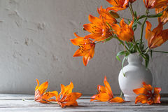 lily in vase on wooden table Stock Images