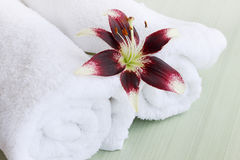 Lily and white fluffy towels Stock Photo