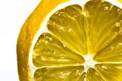 Limão cortado no branco   imagens de stock royalty free