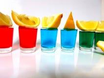 Limão do whitebackground dos greenshots dos blueshots dos redshots do limão da mistura de Mixeddrink Imagem de Stock Royalty Free