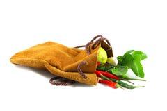 Limão, pimentão, e alho no saco de couro Imagens de Stock Royalty Free