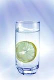 Limón en vidrio Fotos de archivo