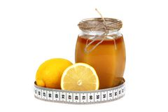 Limón y contador de la miel Imagen de archivo