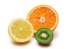 Limón y naranja del kiwi aislados Fotos de archivo