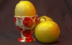 Limões com copo Foto de Stock Royalty Free