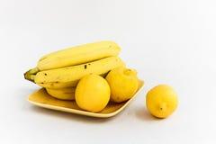 Limões e bananas Foto de Stock
