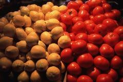 Limões e tomates Fotografia de Stock