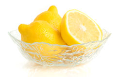 Limões em um prato Fotografia de Stock