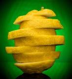 Limões no fundo verde Fotografia de Stock Royalty Free