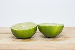 Limões verdes meios imagem de stock royalty free