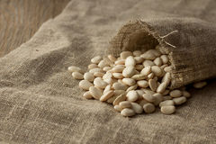Lima beans spread from linen pocket. Selective focus Stock Photography