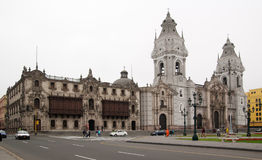 Lima main square Cathedral. Lima Cathredral and Archbishop Palace under an overcast white sky copyspace. Main square, Peru Royalty Free Stock Photo