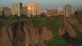Lima Peru Aerial. V62 Flying low besides Miraflores cliff side parks panning with beach views