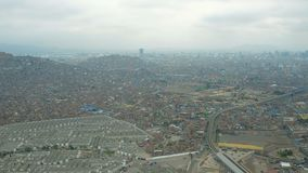 Lima Peru Aerial. V47 Flying near large cemetery in El Agustino district panning with panoramic views stock video