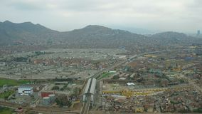 Lima Peru Aerial. V46 Flying over El Agustino district panning stock footage