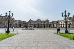 LIMA, PERU - APRIL 15, 2013: Cathedral area in Peru with Horse riding on the street Stock Photos