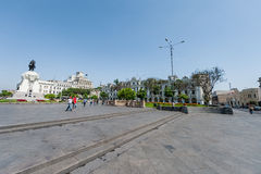 LIMA, PERU - APRIL 15, 2013: Lima Downtown Square with Hero Statue and palace in background stock images