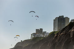 LIMA, PERU - APRIL 14, 2013: Miraflores area in Lima, Ultralight flight over the living area and rocks. Royalty Free Stock Image
