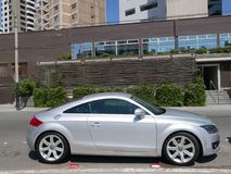 Silver Audi TT coupe in Miraflores district of Lima. Lima, Peru. April 15, 2017. Side view of a parked silver color two doors Audi TT RS coupe. This version of Royalty Free Stock Photos