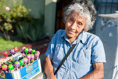 LIMA, PERU - APRIL 12, 2013: An unidentified Peruvian woman selling Chupa Chups sweets on the street. Closeup face Stock Photos