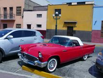 1957 Ford Thunderbird Coupe exhibited in Lima. Lima, Peru. December 4, 2016. Front and side view of a red and white color of a first generation Ford Thunderbird Stock Photos