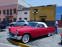Red and white color Ford Thunderbird Coupe, Lima royalty free stock photography