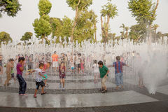 LIMA, PERU - JANUARY 22, 2012: People enjoying hot summer day. In Park of the Reserve. El Circuito Magico del Agua - park with a series of different fountains royalty free stock images