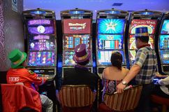 Slot machines in play room royalty free stock images