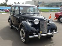 Austin 12 made in the UK in 1946 exhibited in Lima. Lima, Peru. July 23, 2017. Front and side view of a splendid black color Austin 12 made in the UK in 1946 stock photos