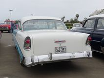 Rear view of a Chevrolet Bel Air coupe in Lima. Lima, Peru. July 23, 2017. Rear and side view of a classic mint condition blue and white Chevrolet Bel Air coupe Royalty Free Stock Photography