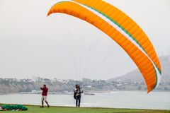 Free LIMA, PERU - JUNE 4, 2015: Paraglider Gets Ready To Fly Over Cliffs Of Miraflores District Of Li Stock Image - 131765711
