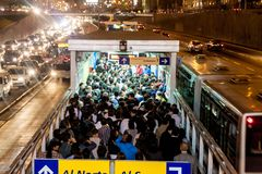 LIMA, PERU - JUNE 4, 2015: Crowd at Metropolitano rapid transport bus system station on Paseo de la Republica roa. D stock photo