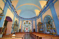 Lima, peru. london, england: brightly colored church interior. praying alone. stock images