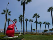 Red heart statue and another heart endind an arrow stock photos
