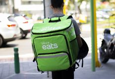 Uber eats man working at food delivery service stock images