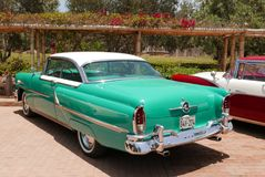 Green and white Mercury Montclair coupe in Lima Stock Photography