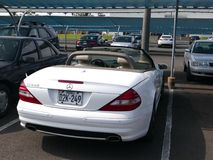White convertible Mercedes-Benz SL550 in Lima. Lima, Peru. October 2, 2016. Rear view of a white convertible Mercedes-Benz SL550 parked in Chorrillos district of Royalty Free Stock Photos