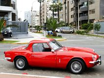 Red Triumph Spitfire MK3 coupe parked in Lima. Lima, Peru. October 24, 2017. Side view of a mint condition two-seat red color Triumph Spitfire MK3 coupe. This Stock Images
