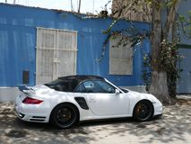 White and black Porsche 911 Turbo parked in Lima. Lima, Peru. October 12, 2017. Side view of a white and and black mint condition Porsche 911 Turbo convertible Stock Images