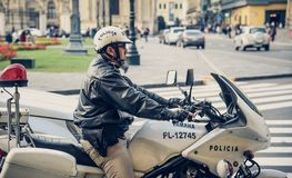 Lima / Peru 07.18.2017 Police officer on patrol. Portrait of a traffic Police Officer on patrol driving the motorcycle in downtown Lima Royalty Free Stock Image