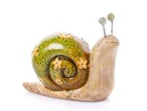 Ślimaczek zabawkarska figurka na bielu Zdjęcia Stock