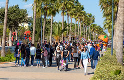 LIMASSOL, CYPRUS - APRIL 1, 2016: People walking by seafront on a sunny day Stock Photo